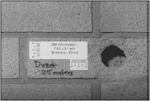Fig. 134 – damage to a clay brick from a bullet fired from 25 meters away.