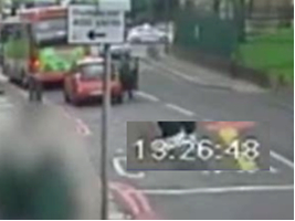 Fig. 256 – is this a police car going past the junction? If so, its occupants aren't interested in the scandalously badly parked truck.