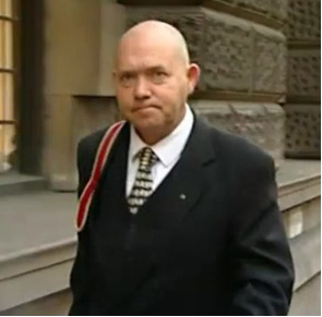 Fig.  36 – Gary Perkins arriving at court, a still from ITN footage.