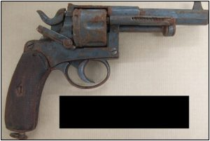 Fig. 71- the rusty antiquated handgun as aimed at police by Adebowale.